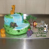 "Jungle Cake 10"" Round, 2 oval pans buttercream and fisher price animals for decoration"