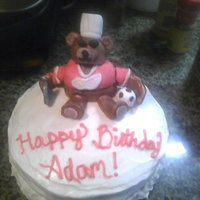 Red Wings Bear Cake  This cake was for my boyfriend's birthday. Adam is known as a bear, he is wearing a chef hat, drinking a beer, holding a soccer ball,...