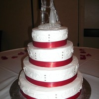 4 Tier   White Buttercream, 1st tier-yellow cake, 2nd-chocolate, 3rd-red velvet-4th-sponge. all with fresh strawberry filling.