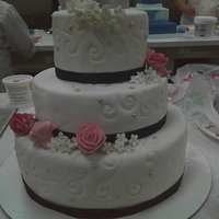 Wedding Cake With Gum Paste Flowers   White fondant, gum paste flowers, and pink luster dust.