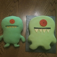 Monster Smash Cake Monster smash cake. The cake is on the right and the original monster it was made to look like is on the left.