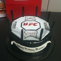 Ufc Cake UFC octagon cake. This has the tapout logo and the xyience logos on it.