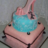 Stiletto On Pillows Made for a teen's birthday party. Gumpaste stiletto sat atop two cake tiers. Pillow was covered in fondant, with chocolate trim and...