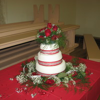 My First Wedding Cake This cake is 3 tiers, each with a different cake and filling flavor. The cake is covered in fondant with red and silver ribbons on each...
