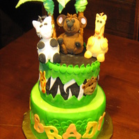 It's A Jungle Out There! First birthday jungle theme... fondant covered red velvet.. everything edible but the top animals...