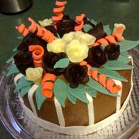 Photo_4.jpg   Chocolate buttercream with fondant accessories and chocolate roses
