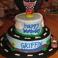 Disney Cars   For a third birthday. Mostly buttercream with fondant accents. The topper is just a candle. TFL!