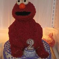 Elmo 12 inch round on bottom, 8 inch round + wonder mold for his body, rice krispy treats shaped with ball pan for the head, shaped rice krispy...