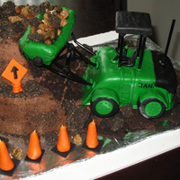 Articulated Front-End Loader  Made for a little boy's 4th birthday. He's a big fan of construction equipment. Chocolate cake and buttercream, MMF, RK, Oreos...