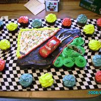 Cars Cake Its a cup-cake cake with extra cup-cakes around it.