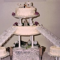 Our Wedding Cake All buttercream. Dont think I had heard of fondant back then. This is our wedding cake. the two center tiers with stairs leading down to...