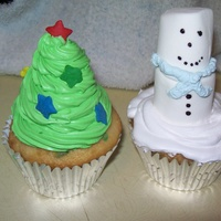 Christmas Tree And Snowman Cupcakes Tree is all icing. Build up like tree with star sprinkles. Snowman is marshmallows held together with frosting and piped icing scarf. Face...