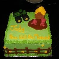 Farewell Cake   buttercream cake. Fondant accents. John Deere toy. Barn, Pigs, and mud are made using colored fondant.