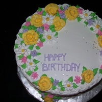 "Flower Basket Cake   All buttercream. Basket weave design. 10"" round. Vanilla cake."