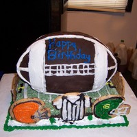 Happy Birthday chocolate football on yellow cake field and cokies for helmets