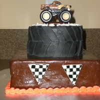 Monster Truck Birthday Cake This was for my son's 4th birthday. He's so into Monster trucks, it's unreal! Cake is lemon with raspberry filling. Brown...