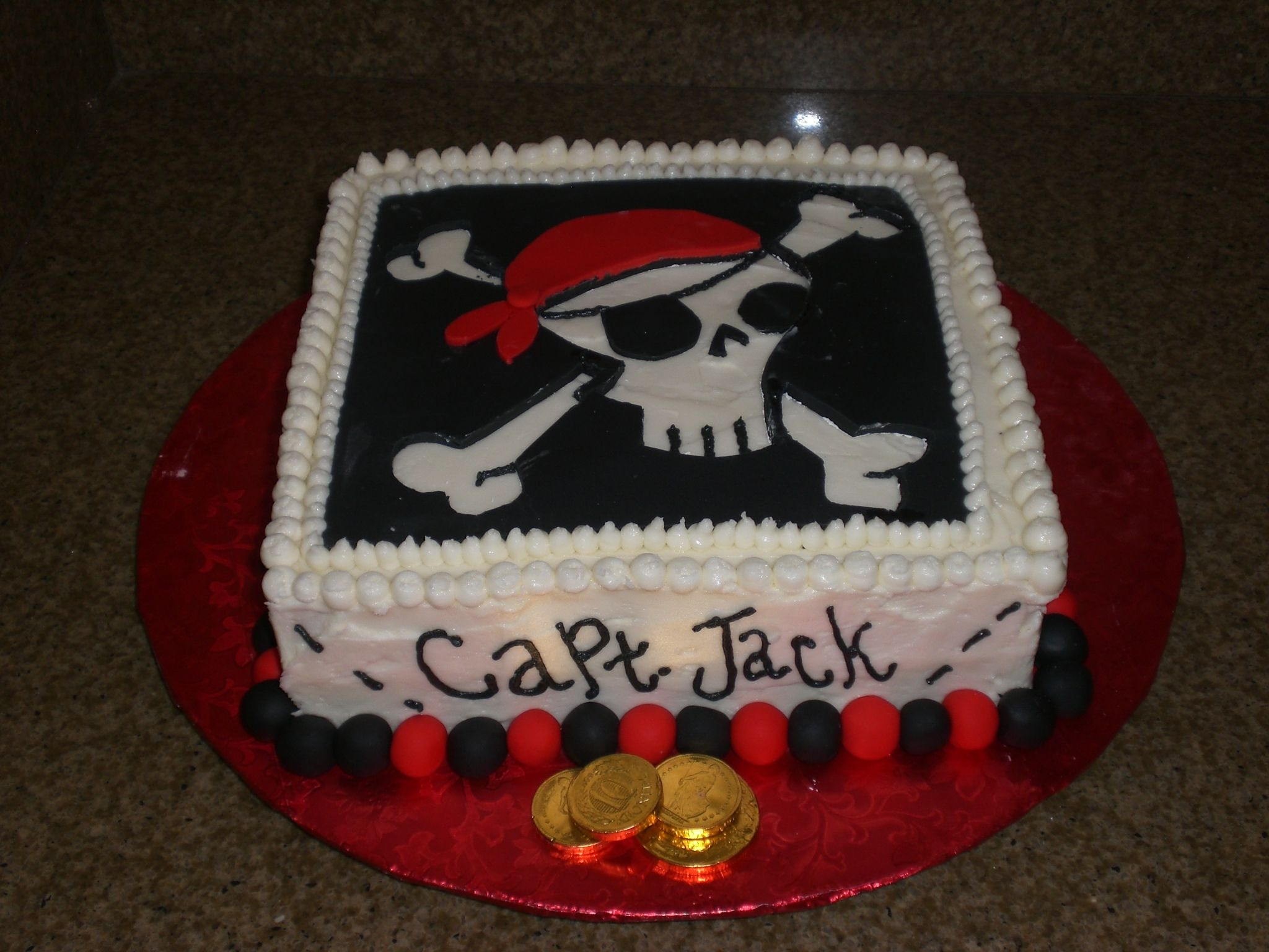 Pirate Cake Lemon cake w/ raspberry filling. Dec. cream cheese frosting. All black and red is fondant. Made for my son's 3rd birthday. Everyon...