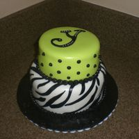 Lime Green Zebra Cake bottom tier is marble cake with choc. ganache filling, covered/accents in fondant. Top tier is white cake with lemon creme filling topped...
