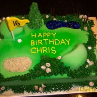 Golf Birthday Cake 9x13 WASC cake with praline flavoured Italian meringue buttercream, covered in fondant; water hazard is blue tinted piping gel and sandtrap...