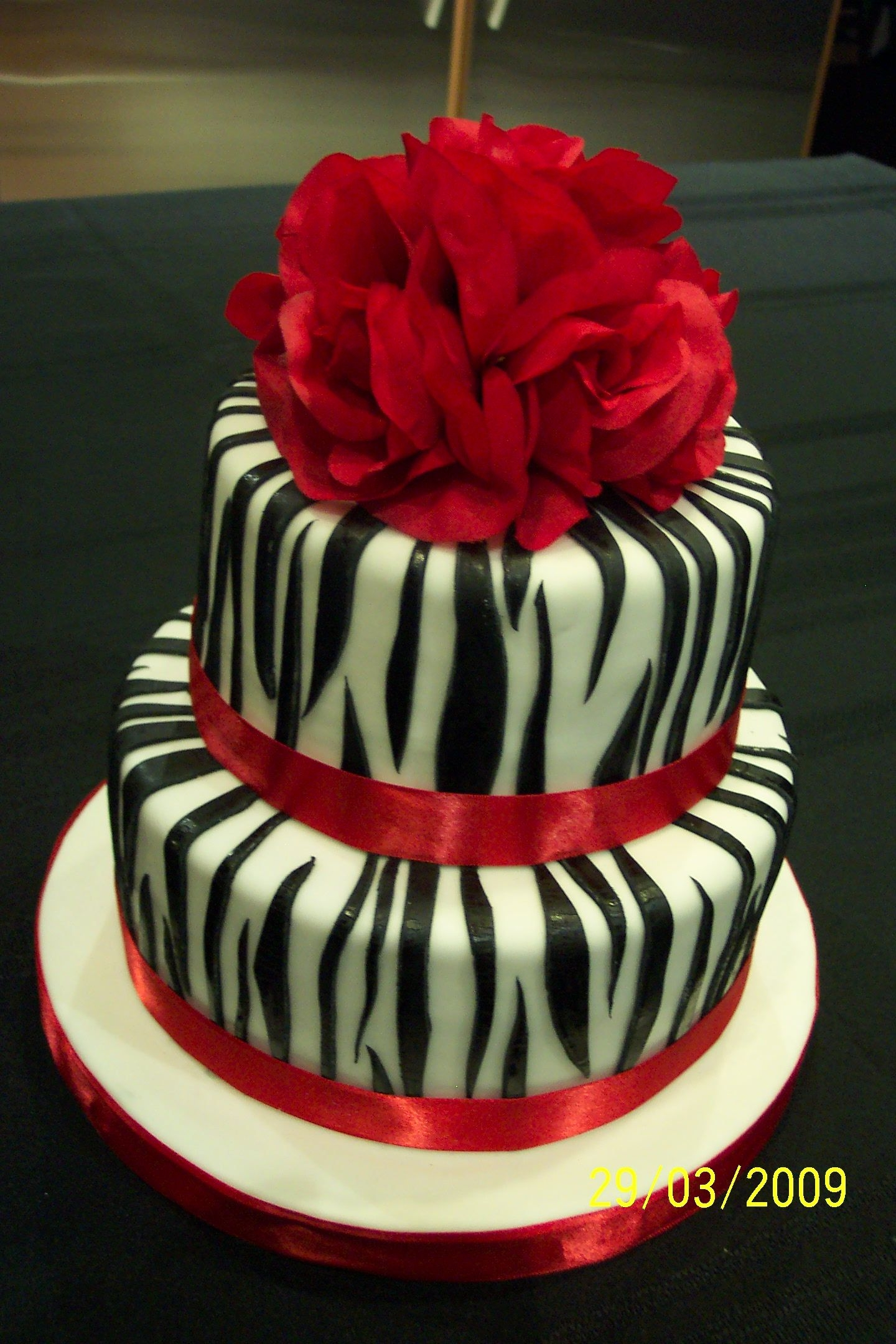 "Zebra Stripes Birthday Cake 8"" and 6"" chocolate cakes with mocha flavoured IMBC; covered in fondant and decorated with fondant zebra stripes. Inspired by all..."