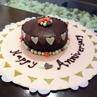 Anniversary Cake   Chocolate cake with whipped cream filling and sugarpaste decorations. Inspired by cakes on this site, of course! TFL
