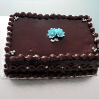 Anniversary   For a friend's Anniversary. Mocha cake with choc ganache and mocha piping. Gumpaste accents. TFL