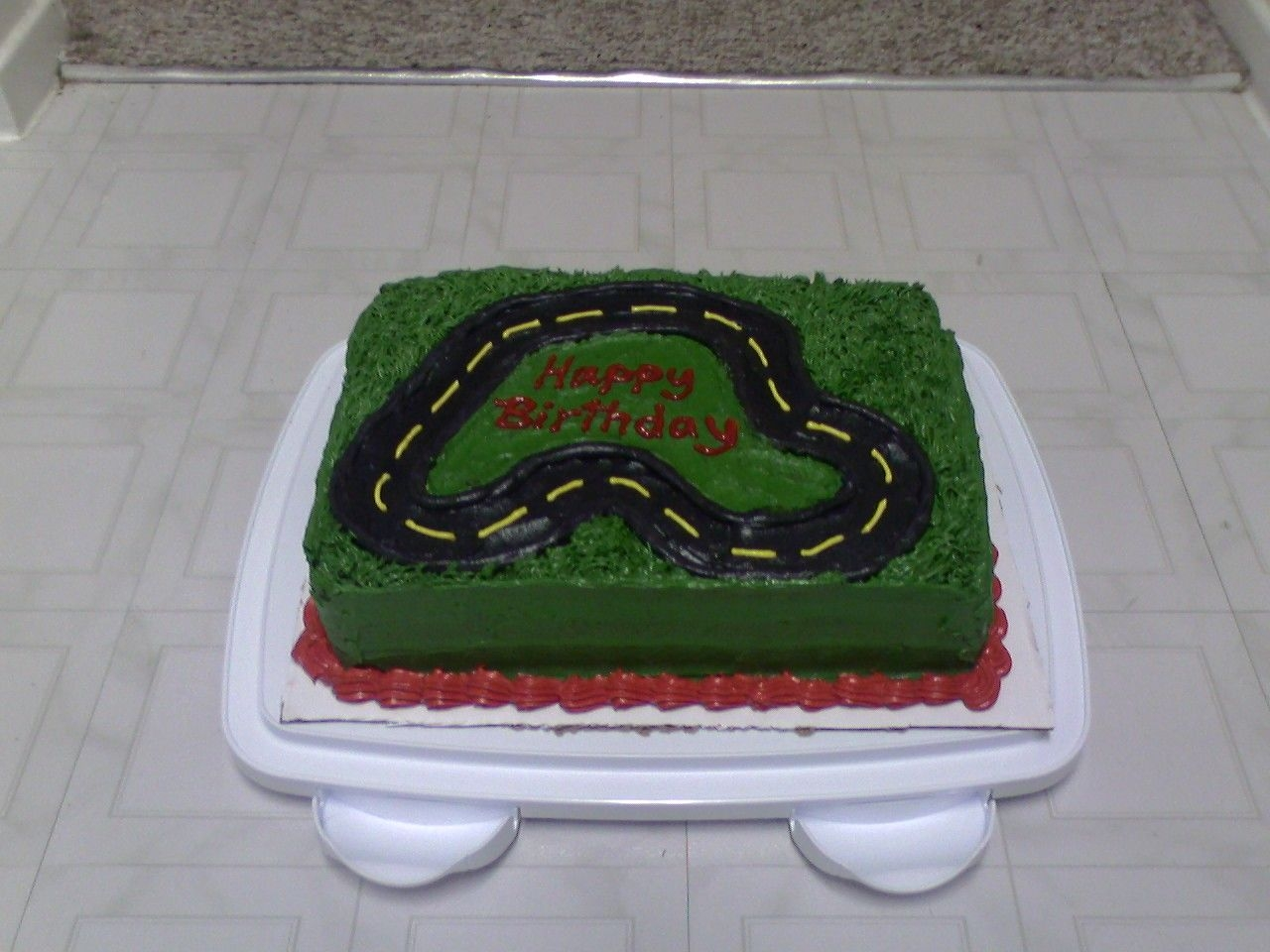 Racetrack Cake Not my favorite, I was in a hurry and the grass didn't turn out how I was picturing it, BC too soft. But it was fun :)
