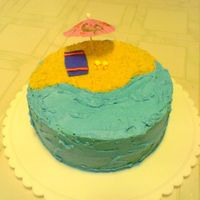 Beach Cake (too?) simple beach cake. Crushed vanilla wafers for sand, fondant sandals/beach towel. BC waves, water
