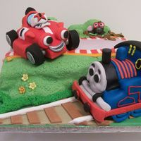 "Red Racing Car And Thomas Tank Engine This was a cake made for two brother sharing the same birthday. One loved the TV character of ""Roary the Racing Car"" whilst the..."