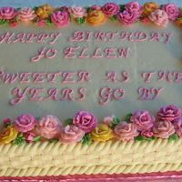 70Th Birthday Roses Sheet cake, with roses and basketweave.