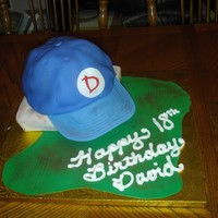 Baseball Cap Got this idea from a book I have for my son's birthday. A Base and ball cap, he loved it! Chocolate cake with fondant and gumpaste...