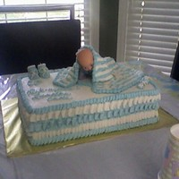 Baby Shower Cute rendition of a cake I saw on another site. Baby is on a board because it was not edible. Blanket is buttercream over plastic wrap. Mom...