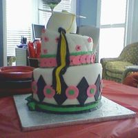 Girl's Grad Cake French Vanilla, pink lemonade filling, fondant icing and trim, cap from gumpaste, tassle from fondant