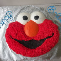 Elmo Chocolate elmo with butter cream icing, with multi-colored cupcakes