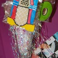 Rock N Roll Cookie Bouquets These were for a 60th birthday that had a rock 'n roll theme. Really fun. I made records, checkerboard 60's, neon music notes,...