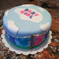 Baby Shower For Girl Entire cake is covered in fondant and accents.Made an outdoor clothes line with blue skies and clouds. With a few color changes it could...