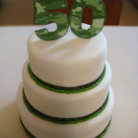 Camouflage Cake For A Hunter On His 50Th Birthday I made this a cake for my uncle who turned 50. He loves to hunt and fish, so I decided to do camouflage. Cake is wrapped in fondant and has...