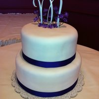 Simple And Elegant Cake With Purple Accent Client wanted simple and elegant. Cake is wrapped in fondant and brushed with pearl dust. It had a nice shine to it.Wrapped bottom of...