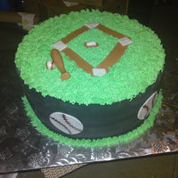 Baseball Yellow cake with BC icing and fondant accents...a one day notice cake...TFL