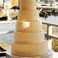 Gate Cake This 5 tier buttercream wedding cake is a 14, 12, 10, 8 and 6 inch. The scroll work was inspired by the gates surrounding the Citadel...