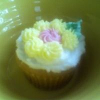 Piped Flower Cup Cake Piped butter cream icing