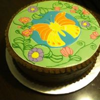 Butterfly Cake Butterfly in royal icing (i traced a stained glass template)Double chocolate butter cream icing to coat cake, shell borders