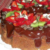 Pastry Art Chocolate pound cake w/ ganache icing and strawberry filling and fresh fruit on top. I got the idea from another member..thanks!