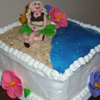Beach Babe Cake Hawaiian themeFondant girl and flowers, Butter cream icing