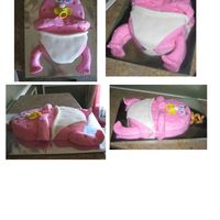 "Baby Peanut  This was made for a baby shower. They referred to the baby as ""peanut"" and wanted a cake to represent the baby. Body is sculpted..."