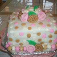 Fondant With Fondant Decorations Yellow cake with fondant icing. Fondant roses and decorations
