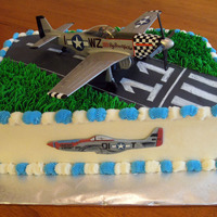P51 Mustang This was for an 11th birthday. The little boy really likes WWll planes. Yellow WASC with cookies and cream filling, BC icing and fondant...