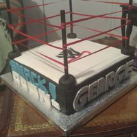 Wrestling Cake this cake was made for my cousin who is a mad wrestling fan! cake is a chocolate cake with chocolate buttercream. cake is covered in...