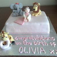 Welcome Olivia here is the finished cake to welcome my boyfriends sisters baby girl olivia to the family! all characters are fondant. cake is a chocolate...