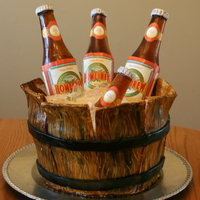 Bucket 'o Beer My first experience with making sugar beer bottles - thanks to CC for the wealth of info/tutorials! Fondant with hand painted wood panels...
